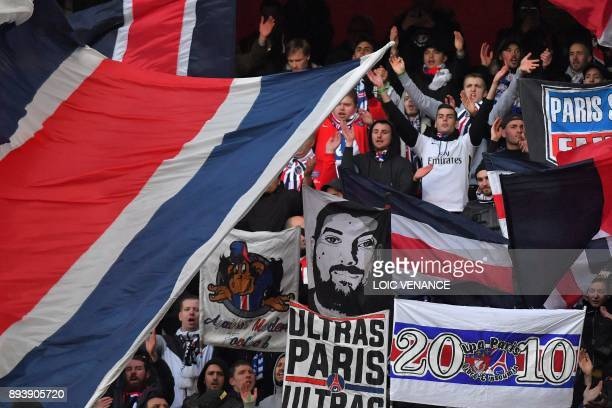 Paris' supporters cheer prior to the French L1 football match between Rennes and Paris Saint Germain on December 16 at the Roazhon Park in Rennes...