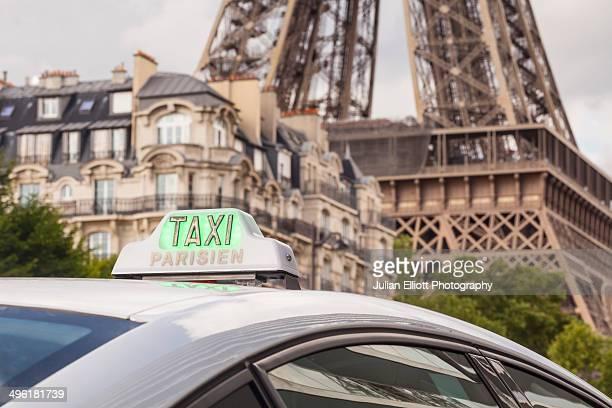 A Paris taxi waiting near the Eiffel Tower