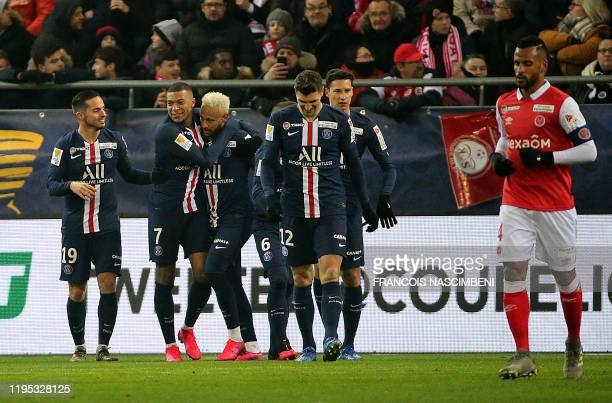 Paris' teammates celebrate after Marquinhos scored a goal during the French League Cup semi-final football match between Stade de Reims and Paris...