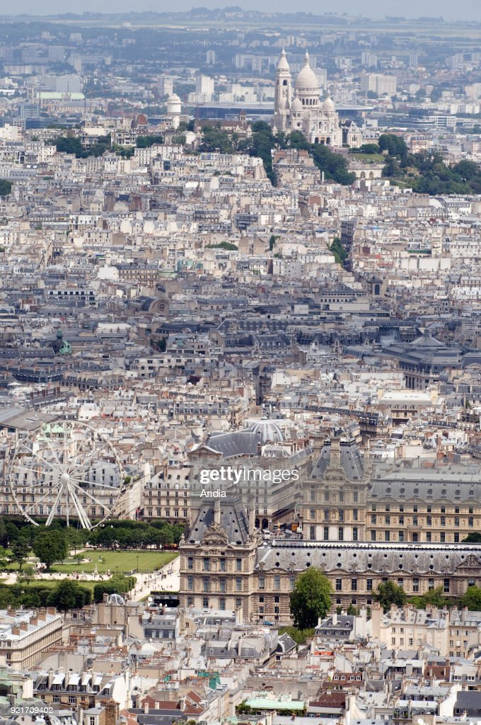 The Louvre Museum and the Basilica of the Sacred Heart of Paris. : News Photo