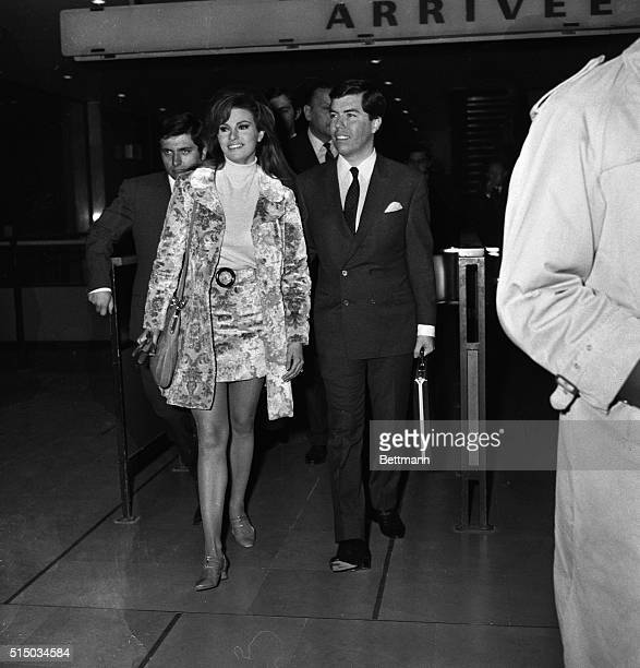This smiling couple arriving in Paris are actress Raquel Welch and manager Patrick Curtis Staying with the same minidress style Raquel married Curtis...