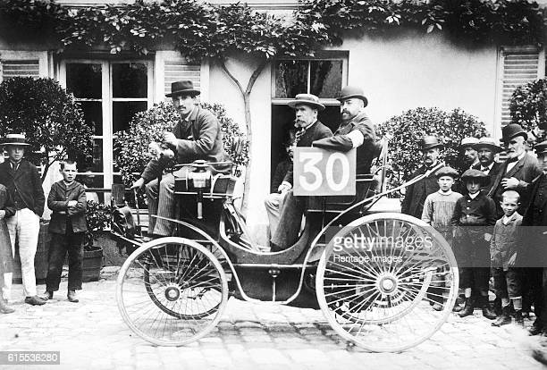 Paris to Rouen race Marchand in Peugeot This motoring competition organised by the newspaper Le Petit Journal s sometimes described as the world's...