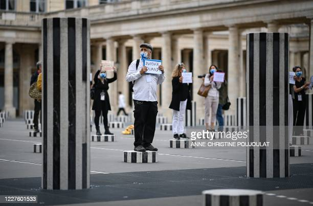 TOPSHOT Paris' tour guides hold placards protesting for their working conditions due to the novel coronavirus disease outbreak as they stand on...