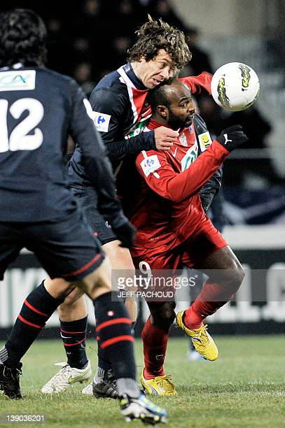 Paris' Uruguayan defender Diego Lugano vies with Dijon's French forward Brice Jovial during the French Cup football match Dijon vs ParisSaintGermain...
