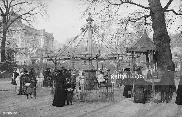 Paris VIIIth district. Carousel in front of the Champs-Elysees circus, Champs-Elysees avenue, demolished in 1899.