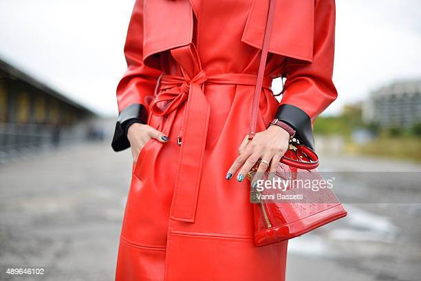 Paris Wang poses with a Louis Vuitton bag before the Gucci show during the Milan Fashion Week Spring/Summer 16 on September 23 2015 in Milan Italy