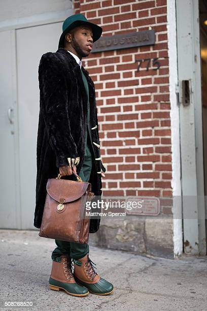 Paris Warren is seen at Industria Superstudios wearing Zara hat and bag HM suit Danny Nguyen Couture fur coat and Tommy Hilfiger shoes during New...