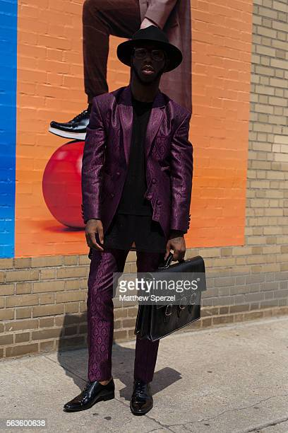 Paris Warren is seen attending the Nick Graham Kenneth Ning John Elliott presentations wearing a purple Clavonswear suit and bag with Danny Nguyen...
