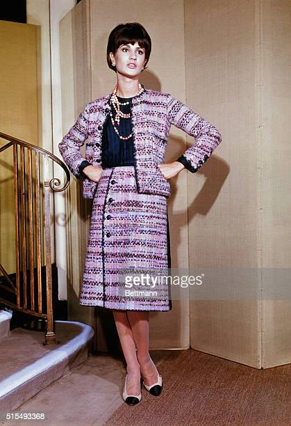 Wrap Around Chic Following her typical silhouette Good Chanel creates this suit for Fall 1963 with a colorful flair The illustrious Paris designer...
