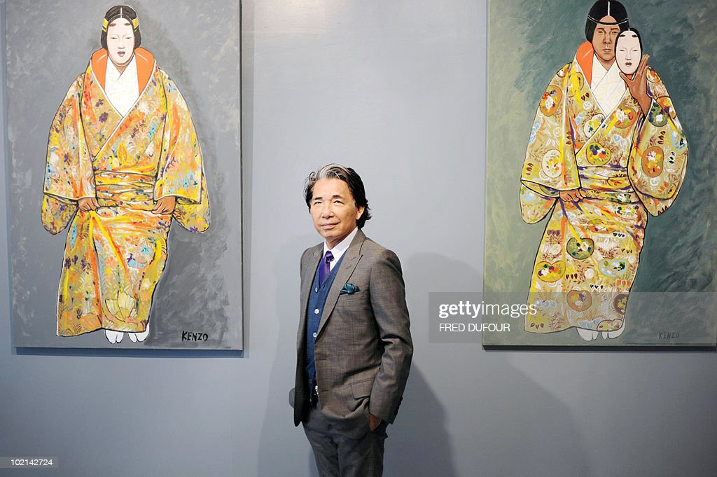 Paris-based Japanese designer Kenzo Takada, aka 'Kenzo', poses near some of his self-portrait paintings on June 16, 2010 in Paris prior to the opening of an exhibition at the Studio 55 gallery presenting notably Kenzo's art work. The collective exhibition intitled 'a certain way of life' runs until July 10, 2010.