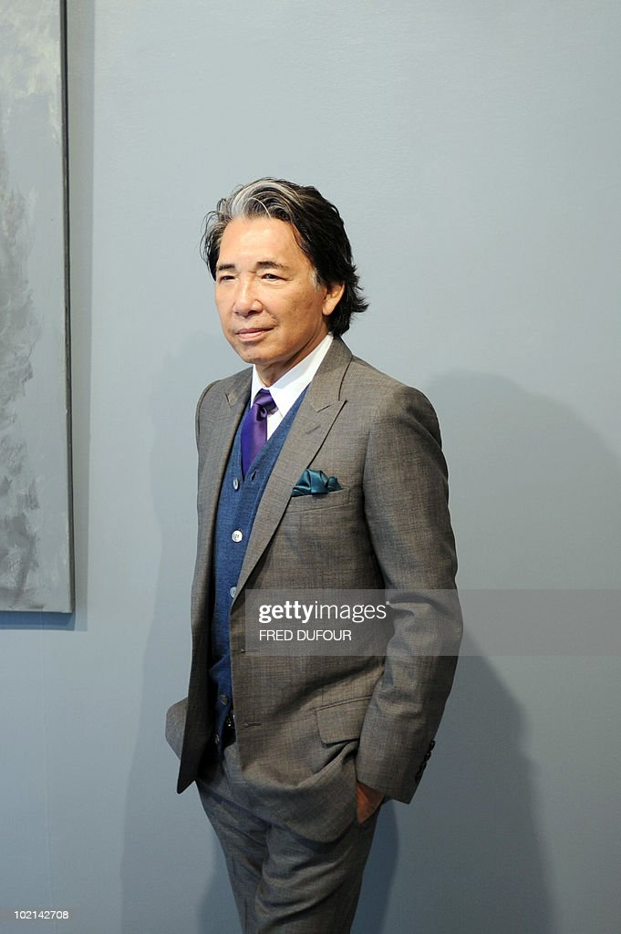 Paris-based Japanese designer Kenzo Takada, aka 'Kenzo', poses on June 16, 2010 in Paris prior to the opening of an exhibition at the Studio 55 gallery presenting notably Kenzo's art work. The collective exhibition intitled 'a certain way of life' runs until July 10, 2010.