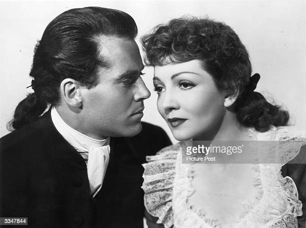 Paris-born American actress Claudette Colbert and American actor Henry Fonda, stars of the 20th Century Fox film 'Drums Along The Mohawk'.