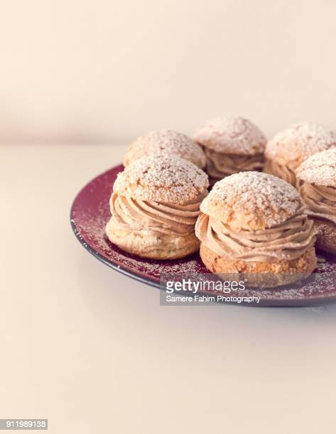 paris-brest with praline - samere fahim stock photos and pictures