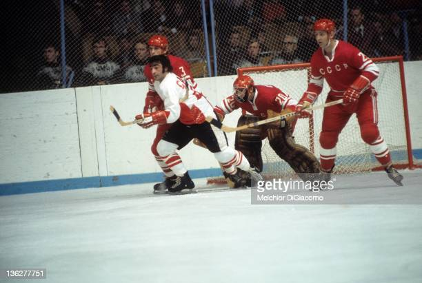 P Parise of Canada battles with Vladimir Lutchenko and Yuri Liapkin of the Soviet Union as goalie Vladislav Tretiak defends the net during the 1972...