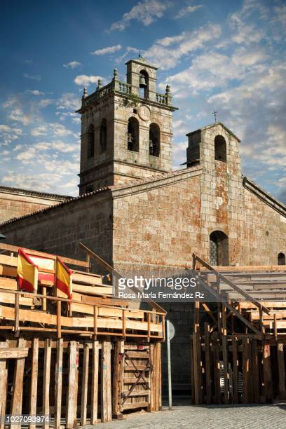 parish church of nuestra señora de la asunción amidst flanked by wooden bullring during annual traditional festival in fermoselle, zamora, castilla y león, spain. - zamora stock pictures, royalty-free photos & images