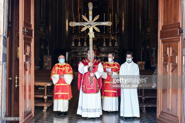 Parish priest of the Santa Maria Assunta church in Pontoglio Don Giovanni Cominardi wearing a face mask starts a Via Crucis procession as part of...