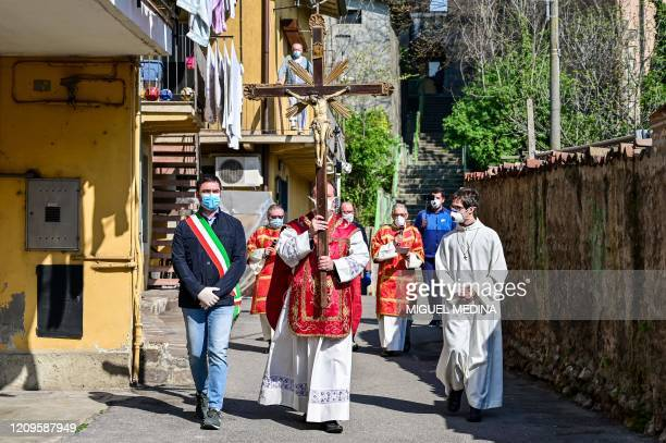 Parish priest of the Santa Maria Assunta church in Pontoglio, Don Giovanni Cominardi , wearing a face mask, escorted by Pontoglio mayor Alessandro...