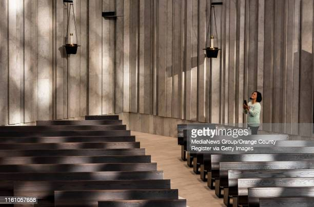 Parishioner Christina Nguyen takes photos of the newly remodeled Christ Cathedral in Garden Grove on Monday, July 8, 2019. The official dedication of...