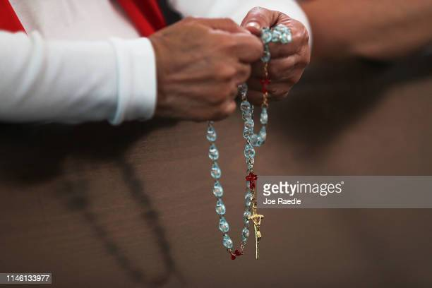 A parishioner holds her rosary as she attends a service at the Our Lady of Guadalupe Catholic church on April 30 2019 in Doral Florida Parishioners...
