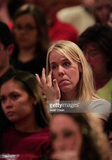 A parishioner of the New Life Christian Fellowship fights back tears during church services held in the student center at Virginia Tech University...