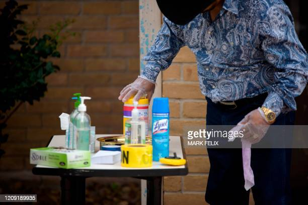 A parishioner uses wipes from a table with disinfectant wipes and hand sanitizer during a Sunday morning service at City On A Hill Church on April 5...