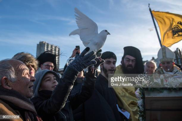 Parishioners and clergy of the Greek Orthodox Church of St Michael the Archangel release doves during a traditional Greek Orthodox blessing at...