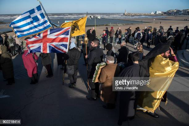 Parishioners and clergy of the Greek Orthodox Church of St Michael the Archangel attend a traditional Greek Orthodox blessing at Margate beach for...