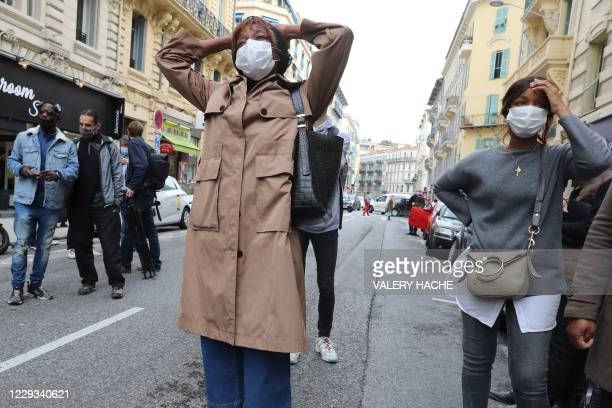 Parishioners cry after in front of the Basilica of Notre-Dame de Nice in Nice on October 29 after three people were killed in a knife attack. -...