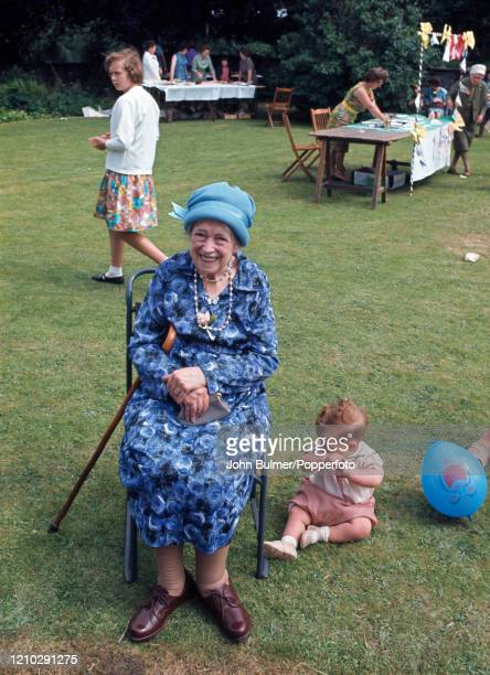 Parishioners enjoying the church fete in the Rectory garden in Pembridge England circa June 1966 During the summer of 1966 British photojournalist...