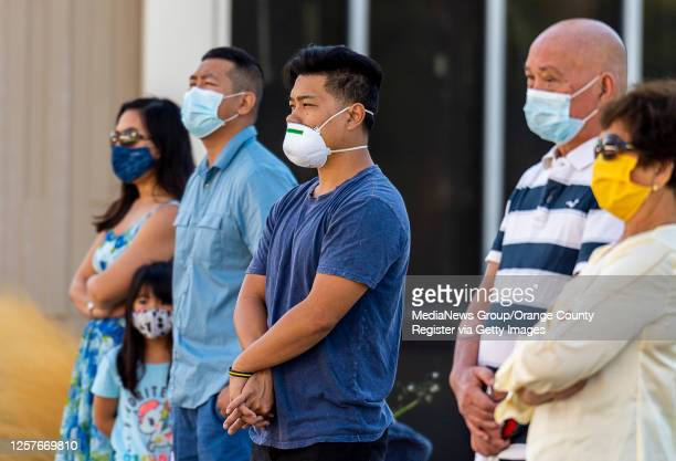 Parishioners gather in the shade of nearby buildings to attend an outdoor mass at Christ Cathedral in Garden Grove on Sunday, July 19, 2020. Services...