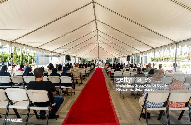 Parishioners gather under the cover of a tent for an outdoor mass at Christ Cathedral in Garden Grove on Sunday, July 19, 2020. Services at Christ...