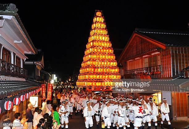 Parishioners march on with illuminated 'Yamagasa' float used in the Kitakyushu City's Tobata Gion Yamagasa at Oharai Dori street on September 24 2010...