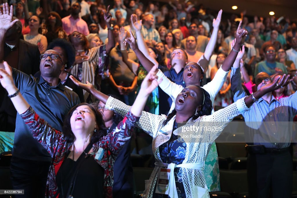 Parishioners of the Lakewood Church led by Pastor Joel Osteen pray together during a service at the church as the city starts the process of rebuilding after severe flooding during Hurricane and Tropical Storm Harvey on September 3, 2017 in Houston, Texas. Pastor Osteen drew criticism after initially not opening the doors of his church to victims of Hurricane Harvey. Harvey, which made landfall north of Corpus Christi on August 25, dumped around 50 inches of rain in and around areas of Houston and Southeast Texas.