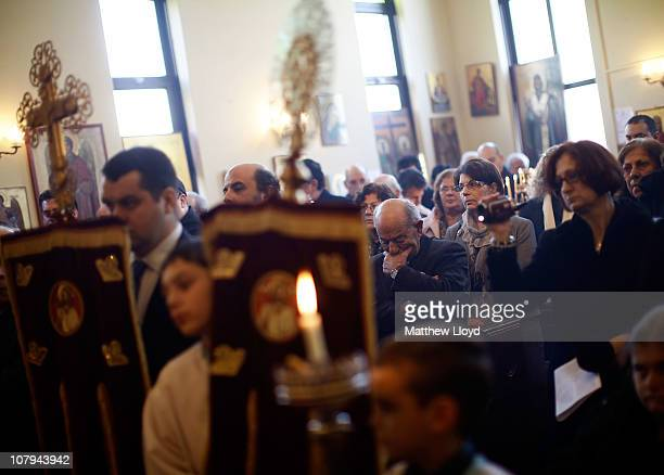 Parishioners pray as His Eminence Gregorios Archbishop of Thyateira and Great Britain presides over the divine liturgy at the Parish of the Greek...
