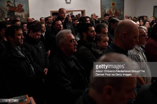 Parishioners pray during a Christmas celebration at St John the Baptist Serbian Orthodox Church on Monday January 6 2020 The Serbian Orthodox church...