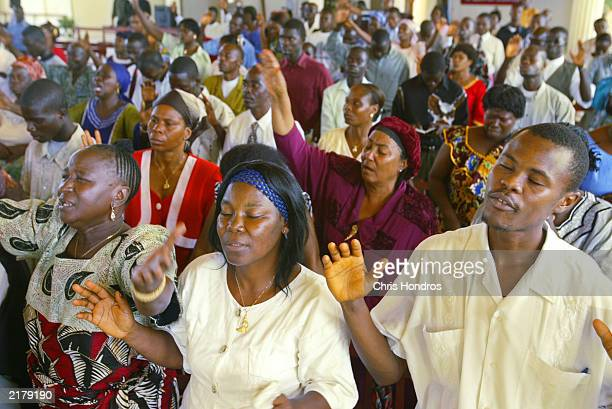 Parishioners pray for peace in the Bethel Cathedral of Hope church July 20 2003 in Monrovia Liberia Despite the perils of a city under attack...