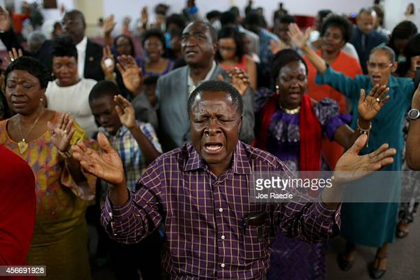 Parishioners pray together during a church service at New Life Fellowship Church on October 5, 2014 in Euless, Texas. The congregation is made up of...