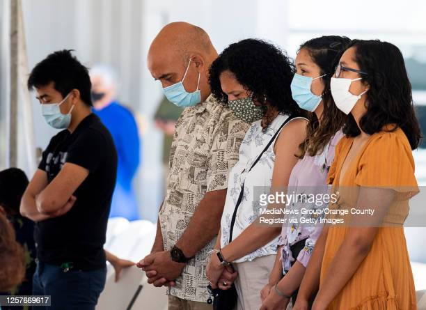 Parishioners pray under the cover of a tent for an outdoor mass at Christ Cathedral in Garden Grove on Sunday, July 19, 2020. Services at Christ...