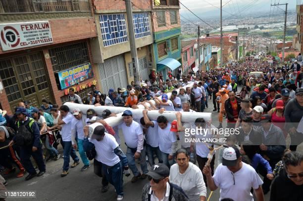 Parishioners take part in a Good Friday procession in Ciudad Bolivar neighbourhood in Bogota on April 19 2019