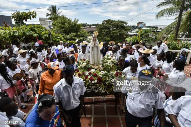 Parishioners take part in a procession with an official international pilgrim virgin statue of Our Lady of Fatima in Timbiqui in the department of...