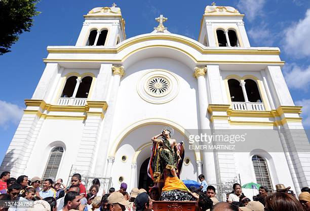 Parishioners take part in the festivities in honor to Saint Sebastian the city's patron saint in Diriamba about 45 km south of Managua on January 20...