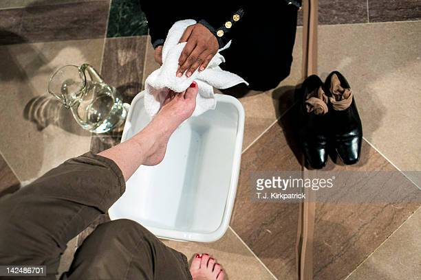Parishioners wash each others' feet during the Maundy Thursday mass celebrating the Last Supper of Jesus and his disciples at the National Cathedral...