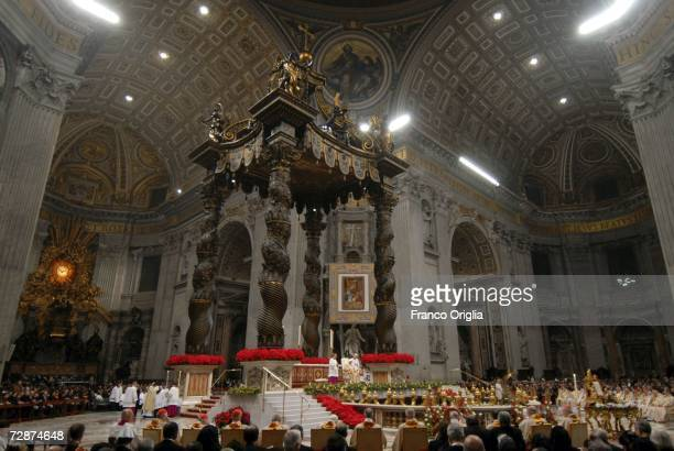 Parishioners watch as Pope Benedict XVI celebrates midnight mass on Christmas Eve at St. Peter's Basilica, December 24, 2006 in Vatican City.