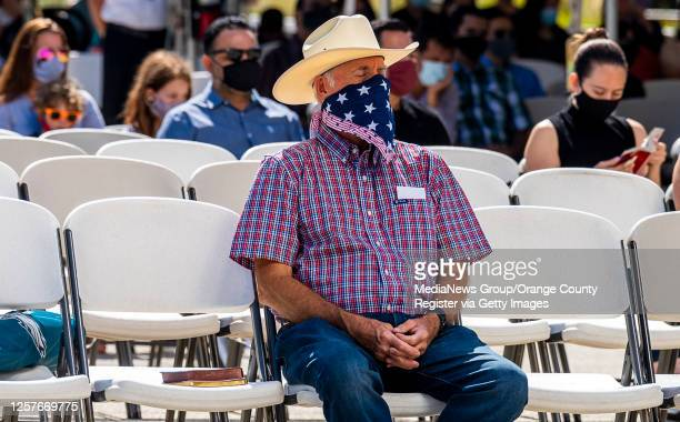 Parishioners wear face masks during an outdoor mass at Christ Cathedral in Garden Grove on Sunday, July 19, 2020. Services at Christ Cathedral have...