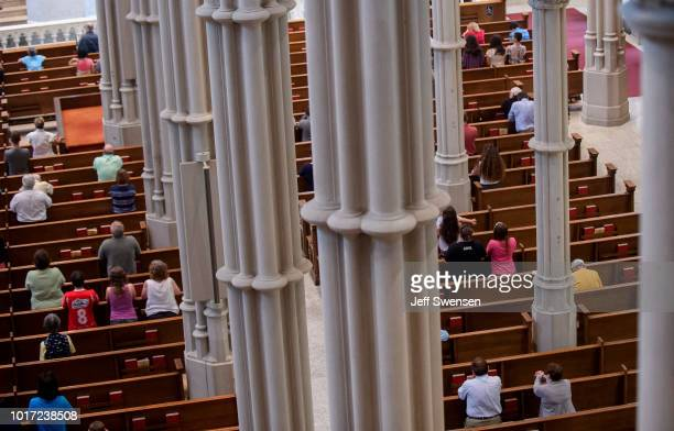 Parishioners worship during a mass to celebrate the Assumption of the Blessed Virgin Mary at St Paul Cathedral the mother church of the Pittsburgh...