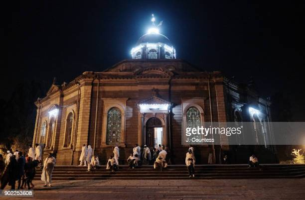 Parishoners of the Ethiopian Orthodox Church depart Kedus Giyorgis Church at the conclusion of the Gena midnight mass at Kedus Giyorgis Church on...