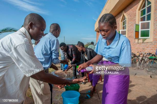 Parishoners wash hands as a preventive measure against the spred of the COVID-19 coronavirus on the last day of full gatherings as a parish at the...