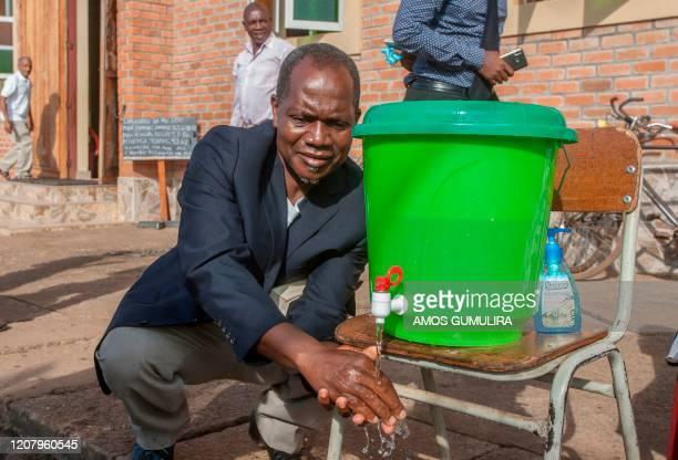 Parishoners wash hands on the last day of full gathering as a parish at the Saint Don Bosco Catholic Parish in Malawis Capital, Lilongwe, March 22,...
