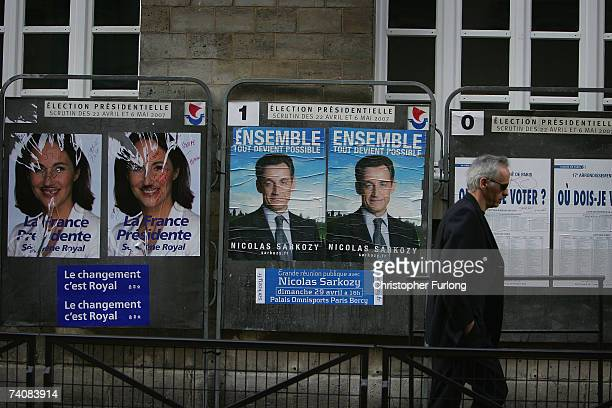Parisian arrives at a polling station in the Ecole Maternelle near to the Arc De Triomphe to cast his vote in the second round of voting in the...