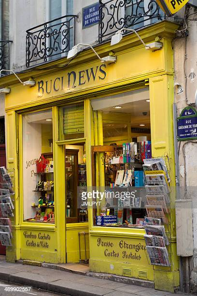 parisian bookshop stationery - magazine rack stock photos and pictures